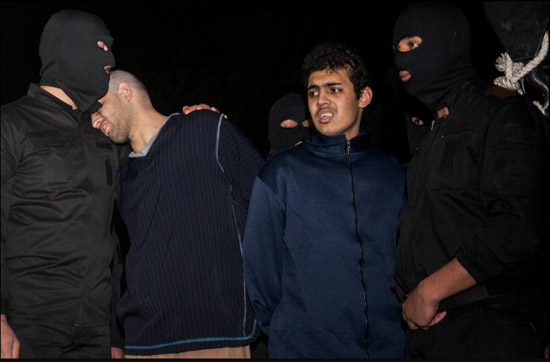 """st before a noose is put on his neck, Alireza Mafiha, 23, lays his head on an executioner's shoulder. Together with Mohammad Ali Sarvari, 20, he was convicted for stabbing a man and stealing the equivalent of $20. The pair were arrested after posting a video on YouTube showing the attack. Though their victim did not die, the judiciary convicted them of being """"mohareb,"""" a Shiite legal term that translates as """"waging war against God"""", a crime that carries the death sentence."""